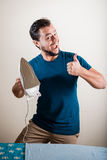 Young stylish man housewife ironing Royalty Free Stock Photography