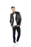 Young stylish man in leather jacket with headphones posing Royalty Free Stock Photo