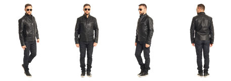 Young stylish man in a leather jacket isolated on white Stock Images