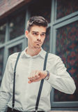 Young stylish man model looking on his watch Royalty Free Stock Photography