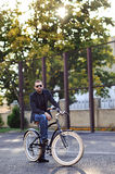 Young stylish man with retro bicycle outdoor Stock Photography