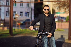 Young stylish man with retro bicycle outdoor Stock Images