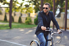 Young stylish man with retro bike Royalty Free Stock Photos