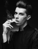 Young stylish man smoking a cigarette Stock Image
