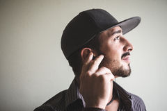 Young stylish man with sport hat Royalty Free Stock Image