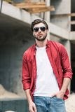 Young stylish man in sunglasses at construction. Building royalty free stock photos