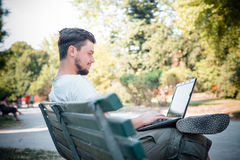 Young stylish man using notebook Royalty Free Stock Photos