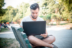 Young stylish man using notebook Royalty Free Stock Image
