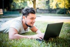 Young stylish man using notebook Royalty Free Stock Image