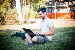 Young stylish man using notebook Royalty Free Stock Images
