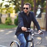 Young stylish man on a vintage bike Royalty Free Stock Photo
