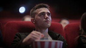 Young Stylish Man watching movie in cinema stock video footage