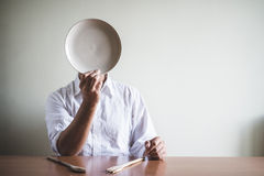 Young stylish man with white shirt and dish in his face Royalty Free Stock Photo