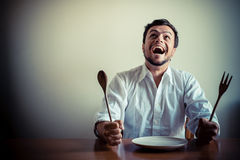 Young stylish man with white shirt eating in mealtimes Stock Images