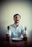 Young stylish man with white shirt eating in mealtimes Royalty Free Stock Photography
