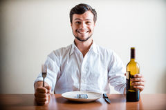 Young stylish man with white shirt and phone on the dish Stock Photos