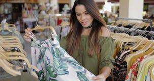 Elegant woman shopping alone stock images