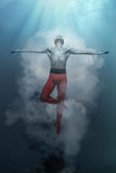 Young and stylish modern ballet dancer on fantasy background. Young and stylish modern ballet dancer jumping on fantasy background Stock Photography