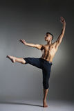 Young and stylish modern ballet dancer. On grey background Royalty Free Stock Photography