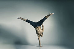 Young and stylish modern ballet dancer. On grey background Royalty Free Stock Photo