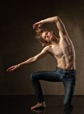 Young and stylish modern dancer on grey background Stock Photo