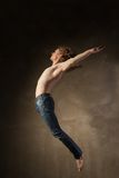 Young and stylish modern dancer on grey background Royalty Free Stock Photography