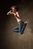 Young and stylish modern dancer on grey background Royalty Free Stock Photo