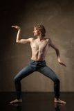 Young and stylish modern dancer on grey background Stock Image