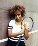 Young stylish mulatto afro-american girl playing tennis, sport h. Ealthy lifestyle people concept close up Royalty Free Stock Photo