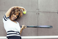 Young stylish mulatto afro-american girl playing tennis, sport healthy lifestyle people concept Stock Images