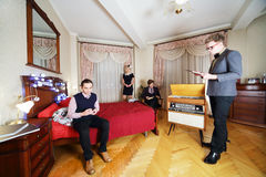 Young stylish people in retro room. Royalty Free Stock Images
