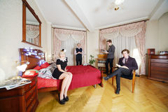 Young stylish people in retro room. Royalty Free Stock Photo