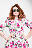 Young stylish red-haired woman with curly hair and pretty face posing in sunglasses. expresses different emotions Stock Photography