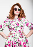 Young stylish red-haired woman with curly hair and pretty face posing in sunglasses. expresses different emotions Royalty Free Stock Images