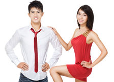 Young, stylish, romantic Chinese couple. Smartly dressed in red and white. Flirtation and romance Royalty Free Stock Image