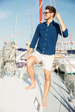 Young stylish sailor man standing on the yacht Stock Photography