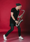 Young stylish saxophonist Royalty Free Stock Photography