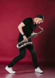 Young stylish saxophonist Royalty Free Stock Image