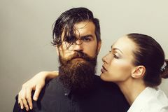 Young stylish sexy couple in studio. Young sexy couple of women with glamour makeup on pretty face in stylish shirt and bra near handsome bearded men with long stock images