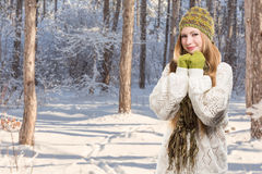 Young stylish smiling blonde woman in variegated melange knitted Royalty Free Stock Photography