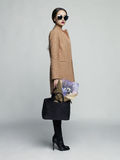 Young stylish woman in beige coat Stock Image