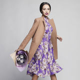 Young stylish woman in beige coat Stock Images
