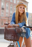 Young stylish woman with a bicycle Stock Photography