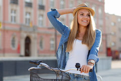 Young stylish woman with a bicycle Royalty Free Stock Image