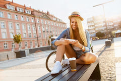 Young stylish woman with a bicycle royalty free stock photography
