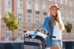 Young stylish woman with a bicycle Royalty Free Stock Images