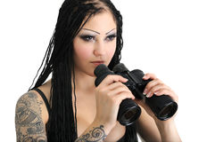 Young stylish woman with binoculars Royalty Free Stock Photo