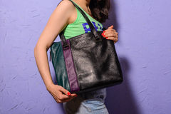 Young stylish woman with black trendy big bag in hand Royalty Free Stock Photography