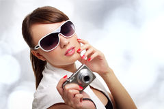 Young stylish woman with a camera Royalty Free Stock Photos