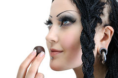 Young stylish woman with dreadlocks. Holding chocolate candy isolated on white royalty free stock images